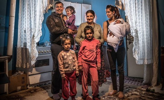A family at home in a Roma settlement in Belgrade, Serbia (file)