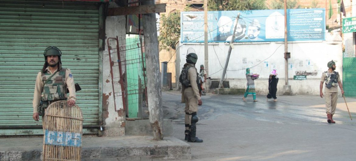 Women walking past Indian security forces in Srinagar, summer capital of the Indian state of Jammu and Kashmir.