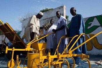 Farmers in Kaffrine, Senegal inspect agricultural machinery.