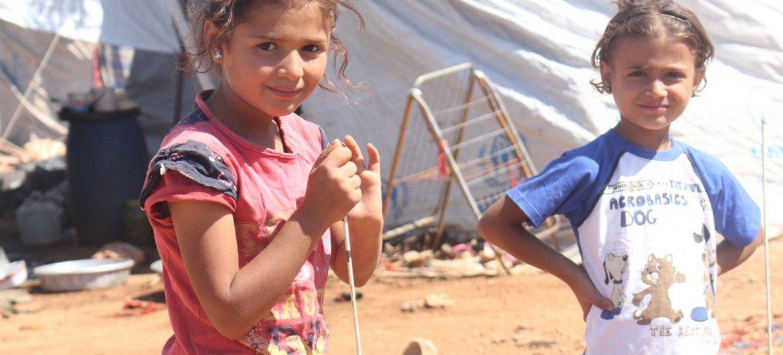 Дети  возле своих палаток  в западной части  Алеппо. Фото ЮНИСЕФ