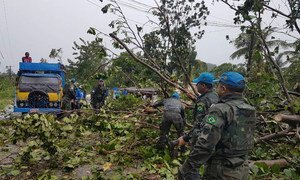 Brazilian Marines with the  UN Stabilization Mission in Haiti (MINUSTAH) clearing the road to les Cayes, Haiti, after the passage of Hurricane Matthew.