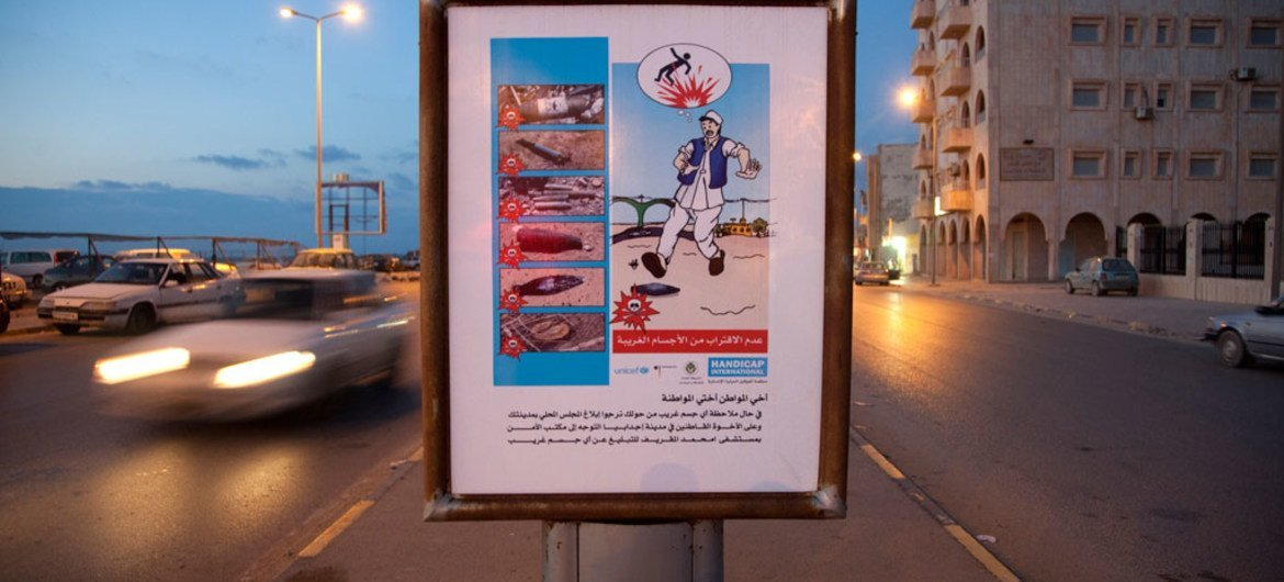 A street sign promotes awareness of explosive remnants of war in the city of Benghazi, Libya. The sign was created by the NGO Handicap International, with support from UNICEF.