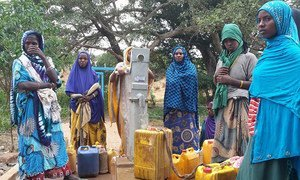 Women fill their containers at a water collection point in the Oromia region of Ethiopia.