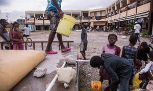 On 9 October 2016 in Les Cayes, Haiti, several hundered people who have lost their homes shelter in a neighbourhood high school.  UNICEF has installed a water bladder on the grounds of the school.