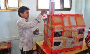 As part of his treatment for mental health, a displaced boy sculpts a replica of his house which was damaged in Sa'ada, Yemen.