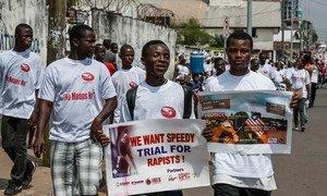 Liberian men march with anti-rape posters (file photo).