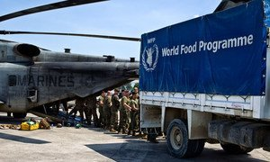 US Marines unloading over 12 tonnes of food items from a World Food Programme (WFP) truck onto helicopters to be sent to Jeremie, Haiti, which was severely hit by Hurricane Matthew.