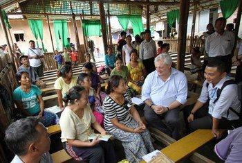 Under-Secretary-General for Humanitarian Affairs, Stephen O'Brien (second right), speaks to people in Kachin state, Myanmar, who are still still displaced after five years of conflict.