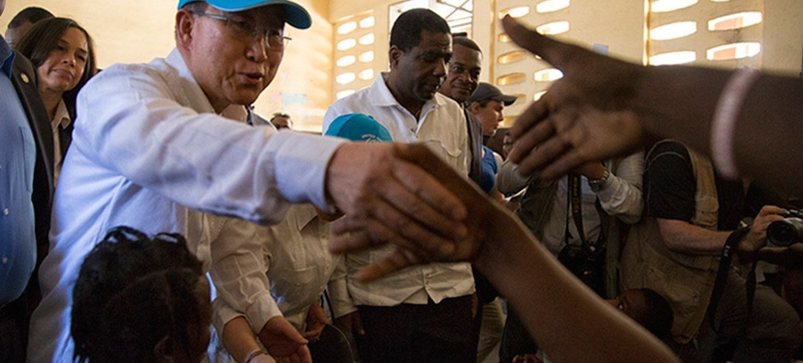 Secretary General Ban Ki Moon greets people at a shelter during his visit to Haiti's western city of Les Cayes, which was heavily damaged by Hurricane Matthew. Photo Logan Abassi UN/MINUSTAH