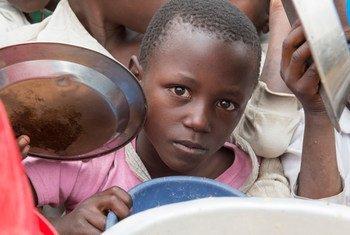 Pupils receive lunch at Bwerangula Primary School in Kitchanga, North Kivu, eastern Democratic Republic of the Congo.
