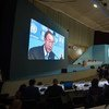 Secretary-General Ban Ki-moon (on wide screens) addresses the opening of the United Nations Conference on Housing and Sustainable Urban Development (Habitat III).