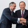 Secretary-General Ban Ki-moon (centre) meets with Mustafa Akinci, Leader of the Turkish Cypriot Community (left), and Nicos Anastasiades, President of the Republic of Cyprus (right).