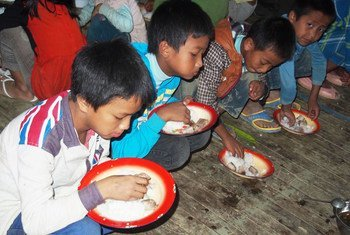 Children having a meal at a school in Hakha city, Myanmar.