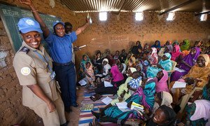 Women in Abu Shouk Camp for internally displaced persons (IDPs) near El Fasher, North Darfur, attend English classes conducted by volunteer teachers and facilitated by the police component of the African Union-United Nations Hybrid Operation in Darfur (UNAMID).
