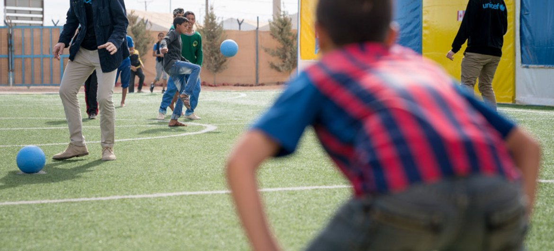 UNICEF Goodwill Ambassador Liam Neeson plays football during a visit to a Makani centre in Za'atari refugee camp in Jordan, 7 November 2016.