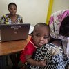 A baby has his general health recorded by a data clerk, as part of an effort to monitor levels of pneumonia post-vaccination in Kilifi District, Kenya. Photo: GAVI Alliance/Evelyn Hockstein