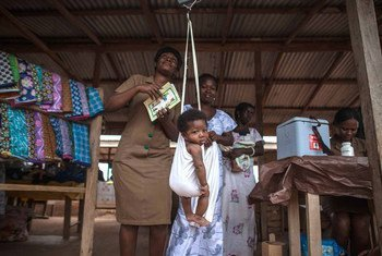 In Ghana, a community health worker weighs babies before administering vaccines. In 2012 Ghana became the first country in Africa to simmultaneously introduce vaccines against pneumococcal disease and rotavirus, targeting the world's leading killers of children – pneumonia and diarrhoea.