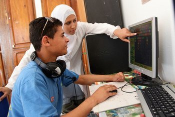 Innovators using a specialised computer.