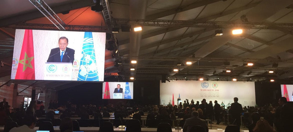 Secretary-General Ban Ki-moon (on screens) addresses a high-level event on accelerating climate action in Marrakech.