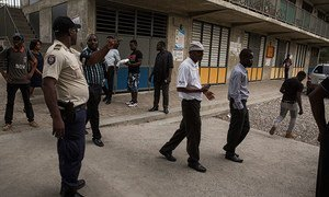 Members of the Haitian National Police escort voters out of the polling centre at 4 pm when the polls closed for national elections for the first round of Presidential and second and third round for senators, in Port au Prince, Haiti, November 20, 2016.