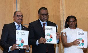 Executive Director of UNAIDS, Michel Sidibé (left) with President of Namibia, Hage Geingob and his wife Monica, at the launch of Get on the Fast-Track: the life-cycle approach to HIV, in Windhoek, Namibia.