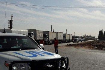 من الأرشيف - قافلة مساعدات إنسانية تصل إلى حمص