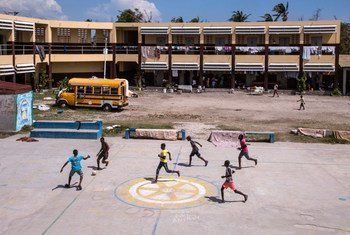 Boys play football in the yard of the school in Les Cayes, Department du Sud, Haiti, which is being used as a living space or shelter for several hundred people who have lost their homes to Hurricane Matthew.