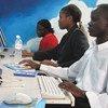 Young people using computers in Kampala, Uganda.