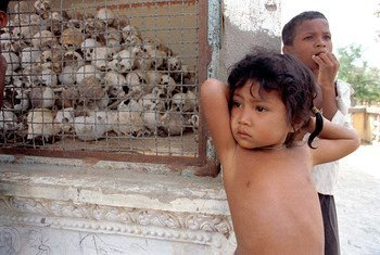 """Young children at the """"Killing Fields"""" memorial, located on the outskirts of Phnom Penh. Large numbers of teachers, academics, artisans and professional workers were killed when the country was under the rule of the Democratic Kampuchea regime between 1975 and 1979."""