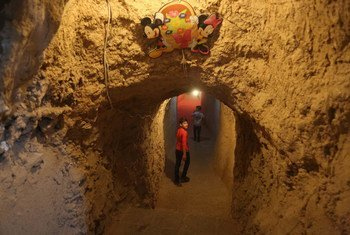 In Syria, Abdulaziz, 10, who lost his father during the war, comes to the 'Land of Childhood' underground playground to play and spend time with his friends.