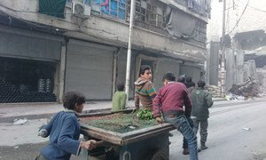 On 20 November 2016, a group of children push a cart trying to sell some radish in Al-Sha'ar neighbourhood in Aleppo, Syria. Food and other basic commodities are running out at one of East Aleppo's once busiest markets.