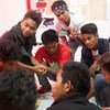 Youth volunteers and counsellors discussing protection against HIV through correct knowledge and skills, with a group of adolescent boys in Zamboanga City, Philippines. Photo: UNICEF/UNI177053/Palasi