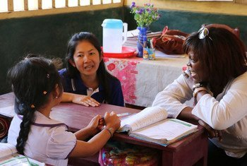 WFP Executive Director Ertharin Cousin (right) talks to a student at Park Chim school in Luang Prabang Province, Laos.