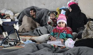 Families that fled fighting in eastern Aleppo, Syria, take refuge in a large warehouse in Jibreen.