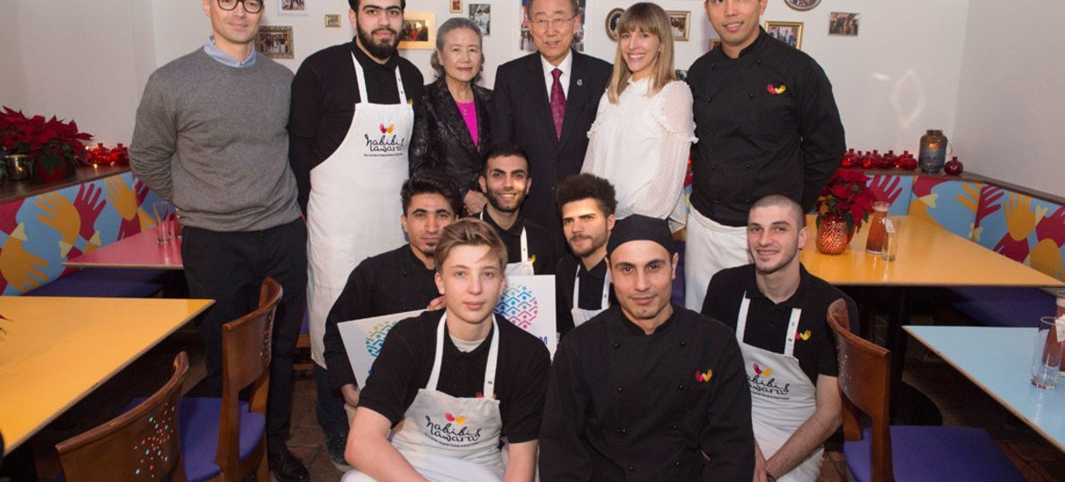 """Secretary-General Ban Ki-moon (rear centre right) and his wife Yoo Soon-taek (rear centre left), pose with the staff of the Habibi & Hawara Restaurant in Vienna. the visit was aimed at showcasing the UN-System-Wide Campaign, """"TOGETHER: Respect, Safety & Dignity for All."""""""