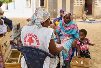 A home-based caregiver in a village near Kayar, Senegal, provides basic healthcare services, including malaria treatment for patients living in areas where there are no healthcare facilities.