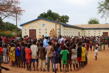 Displaced children seek safety with their families in a churchyard in Kaga Bandoro, Central African Republic.