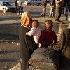 Civiles a la espera de ser trasladados en Alepo. Foto: OCHA/L.Tom