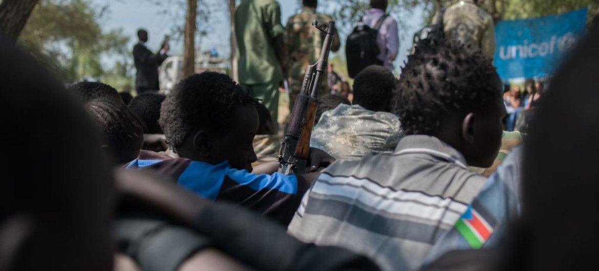 On 26 October 2016, children associated with the Cobra faction wait to be demobilized in Pibor, South Sudan. A total of 145 children from the Cobra Faction and SPLA-IO were disarmed and released by the two armed groups.