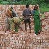Stacking bricks at a factory near Dhaka, Bangladesh, a least developed country.