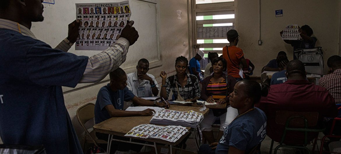 Ballots being counted after the closing of Haiti's national elections for the first round of Presidential and second and third round for senators, in Port au Prince, Haiti, November 20, 2016.