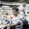 Migrante trabajando en el sector textil de Jordania. Foto: OIT/Sami Haven.