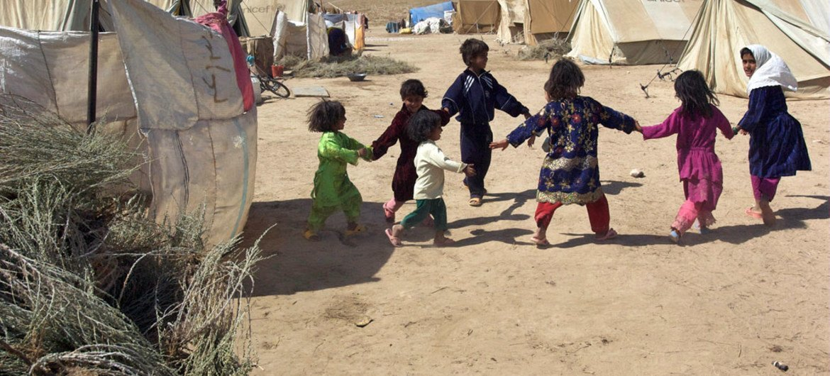 Children play in the Sosmaqala Internally Displaced Persons (IDP) Camp in northern Afghanistan. The camp is comprised of returned Afghans following many years as refugees in neighbouring Iran. 30/Aug/2009. Sar-e-Pul, Afghanistan.