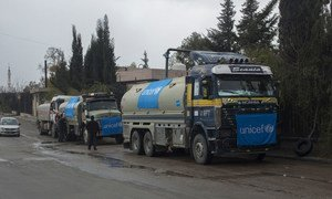 UNICEF-supported trucks queue to fill their tanks with water from a group of wells rehabilitated and equipped by UNICEF, Damascus, Syria. UNICEF/UN048100/Al-Asadi