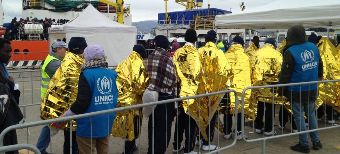 UN refugee agency (UNHCR) staff receive survivors at the dock of the Sicilian port of Messina, Sicily.