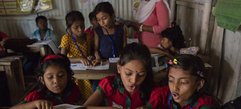 Students participate in class while listening to teacher at the Sujat Nagar urban slum school in Dhaka, Bangladesh.