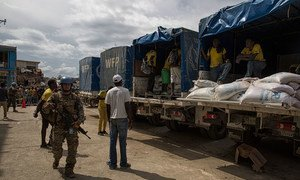 MINUSTAH peacekeepers provide security at a WFP distribution point in Jeremie, Haiti, which was severely impacted by Hurricane Matthew on Tuesday 4 October 2016.