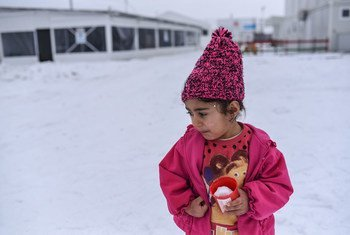 On 18 January 2017, in the Tabanovce refugee and migrant centre, former Yugoslav Republic of Macedonia, a Syrian girl, carries a plastic cup filled with snow.