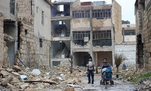 In east Aleppo City, Syria, children collect water for their family in Shakoor neighbourhood.