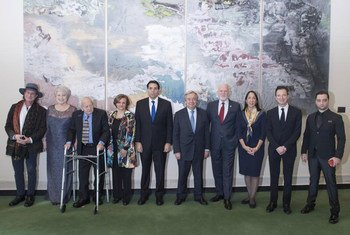 Secretary-General António Guterres (fifth right) poses for a group photo with participants of the UN Holocaust Memorial Ceremony, on the occasion of the International Day of Commemoration in Memory of the Victims of the Holocaust.